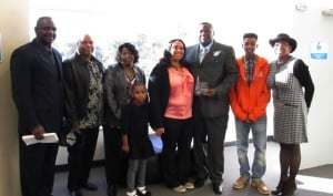 Johnnie Dwayne Upson, center, with his family, Coalition staff Jack Johnson (far left) and Board member Joy Burgess (far right)