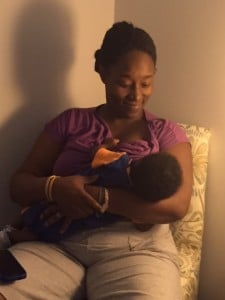 A mom breastfeeds in the new Live Love Latch Room.